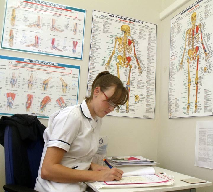 Physiotherapist Nicola Hodgson writing a report
